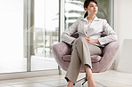 Waiting - Young business woman sitting on a chair