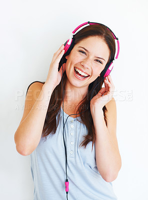 Buy stock photo An attractive young lady listening to music