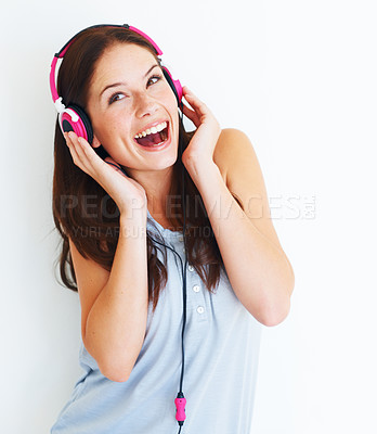 Buy stock photo Portrait of a young attractive woman listening to music
