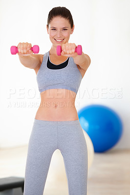 Buy stock photo Portrait of a beautiful young woman training with dumbbells at the gym