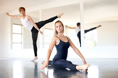 Buy stock photo Young dancers practicing in a studio