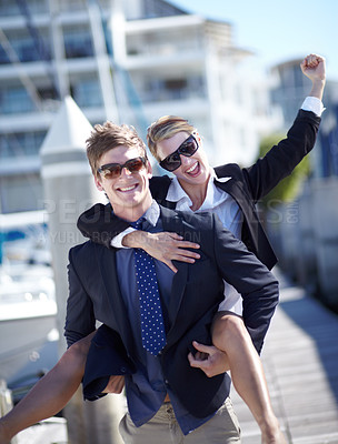 Buy stock photo Young business couple celebrating their success at the marina