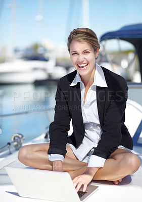 Buy stock photo Young businesswoman working on her yacht with a smile