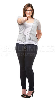 Buy stock photo A pretty full-figured woman pointing at you while isolated on white