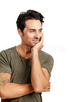 Buy stock photo A handsome young man leaning on his hand