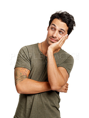 Buy stock photo A handsome young man looking bored