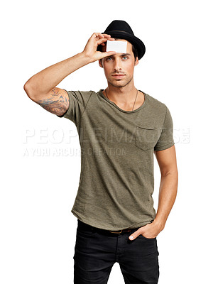 Buy stock photo A handsome young man holding a blank business card against his head