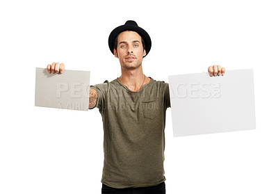 Buy stock photo A handsome young man holding up two placards