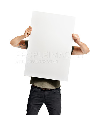 Buy stock photo A young man hiding behind copyspace
