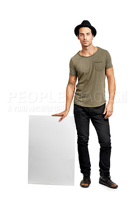 Buy stock photo A handsome young man holding a placard