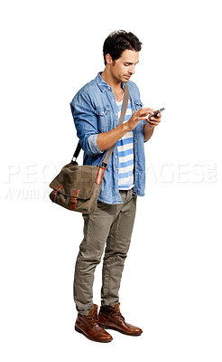 Buy stock photo A handsome young man standing against a white background while texting someone