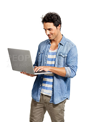 Buy stock photo A handsome young man working on his laptop against a white background