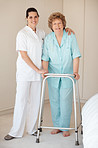 Portrait of a nurse and a senior woman with a walker