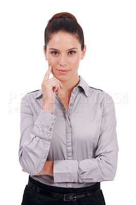 Buy stock photo Studio portrait of a young business woman with her hand on her chin isolated on white