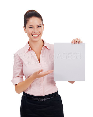 Buy stock photo Studio portrait of an attractive young woman holding up a blank sign isolated on white