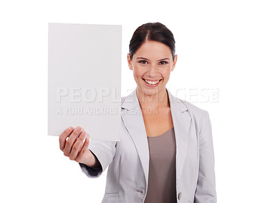 Buy stock photo Shot of a young women pointing at a small blank sign while isolated on white