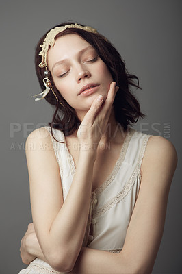 Buy stock photo A beautiful young woman wearing vintage clothing and posing with eyes closed and hand on her neck