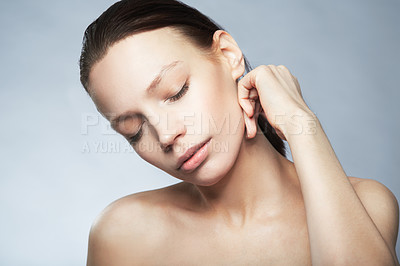 Buy stock photo Head and shoulder shot of a beautiful young woman in the nude with eyes closed and hand touching her neck