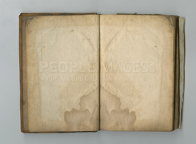 Buy stock photo A yellowed piece of parchment inside an old book