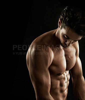 Buy stock photo Muscular young man showing off his defined body