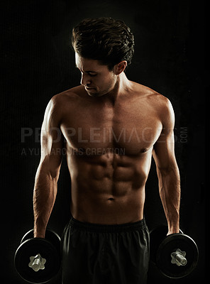 Buy stock photo Built young man holding his dumbbells to his sides, ready for a workout