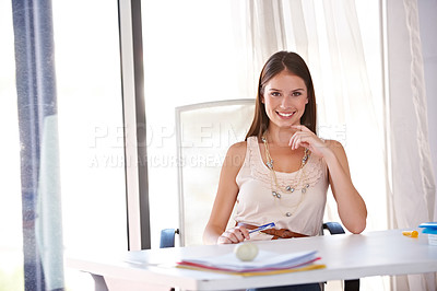 Buy stock photo A gorgeous young designer sitting at her desk in the office