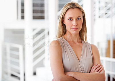 Buy stock photo Portrait of an ambitious businesswoman standing in the office