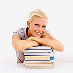 Cute young female with a stack of books