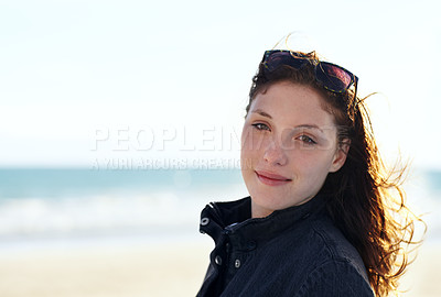 Buy stock photo Portrait of a young woman standing on a beach