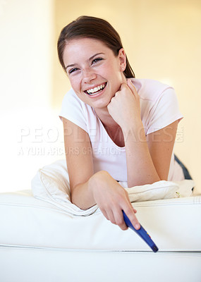 Buy stock photo A gorgeous young woman lying on her bed watching tv
