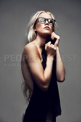 Buy stock photo Portrait of a gorgeous young woman posing in the studio