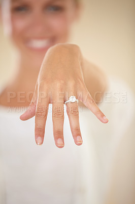 Buy stock photo Cropped shot of a young woman showing off her engagement ring
