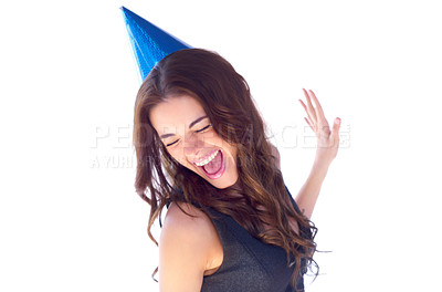 Buy stock photo An attractive young woman dancing while wearing a party hat