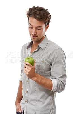 Buy stock photo A handsome young man holding an