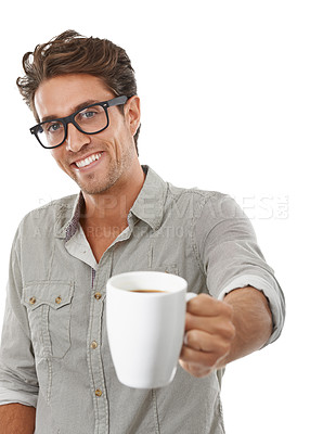 Buy stock photo Portrait of a handsome young man offering you a cup of coffee