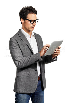 Buy stock photo A handsome young man working on his tablet