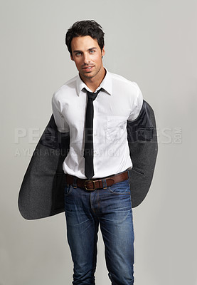 Buy stock photo Portrait of a handsome young man putting on his blazer