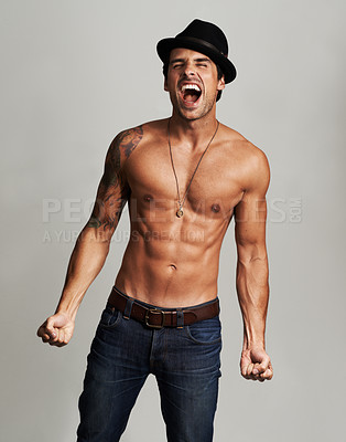 Buy stock photo A shirtless young man wearing a hat and screaming with his eyes closed