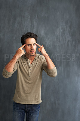 """Buy stock photo Portrait of a handsome young man gesturing for you to """"think"""""""