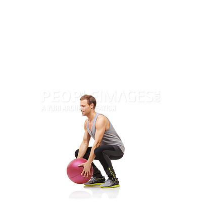 Buy stock photo A young man working out with a medicine ball on a white background