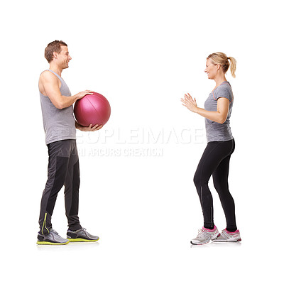 Buy stock photo A man and woman exercising  by throwing a medicine ball to each other