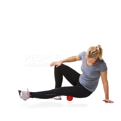 Buy stock photo A young woman working out using an exercise ball