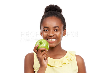 Buy stock photo Portrait of a young african american girl holding up an apple isolated on white