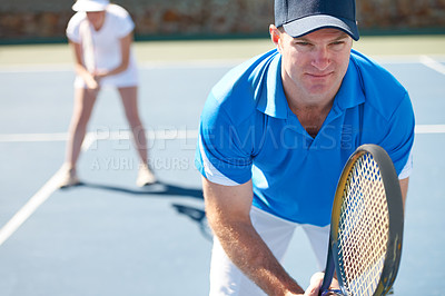 Buy stock photo A mixed doubles team standing ready to receive a serve - Tennis