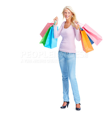 Buy stock photo Full length of a happy young woman holding shopping bags over white background