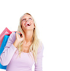 Happy young woman with colorful shopping bags, looking up