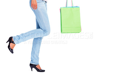 Buy stock photo Low section of a female holding many shopping bags isolated on white