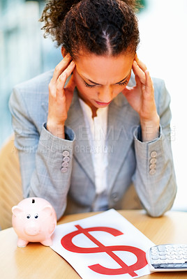 Buy stock photo Tensed young African American business woman about the financial crisis