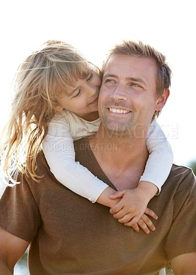 Buy stock photo A young father carrying his smiling daughter on his back