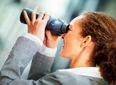 Buy stock photo Happy young business woman looking through  binoculars